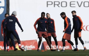 FC Barcelona's Lionel Messi, second right, takes part during a training session with his teammates at the Sports Center FC Barcelona Joan Gamper in Sant Joan Despi, Spain, Saturday, Feb. 10, 2018. FC Barcelona will play against Getafe in a Spanish La Liga soccer match on Sunday. (AP Photo/Manu Fernandez)