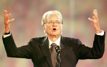 Rev. Billy Graham speaks to a crowd of more than 70,000 at Ericsson Stadium in Charlotte, N.C., Thursday, Sept. 26, 1996 on the first night of the Carolinas Billy Graham Crusade. The crusade runs through Sunday, Sept. 29.  (AP Photo/Peter A. Harris)