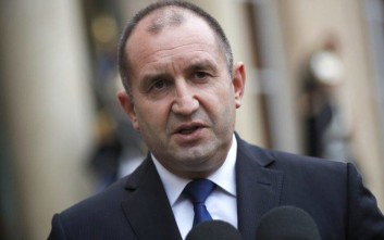 FILE- In this file photo dated Monday, Dec. 4, 2017, Bulgarian president Rumen Radev after a meeting with French President Emmanuel Macron, at the Elysee Palace, in Paris, France.  Bulgaria's president Radev on Tuesday Jan. 2, 2018, vetoed an anti-corruption law approved by Parliament, saying it's not strong enough to effectively combat corruption. (AP Photo/Christophe Ena, FILE)
