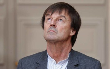 French Minister of the Ecological and Social Transition Nicolas Hulot looks up in Paris, Wednesday, Jan.17, 2018 while France's prime minister Edouard Philippe says that the government has decided against building an airport in western France that has mobilized nearly a decade of sometimes violent protests and he told protesters occupying the site that they must leave. (Charles Platiau, Pool via AP)