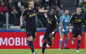 Tottenham's Harry Kane, left, celebrates with teammate Serge Aurier after scoring his side's opening goal during the Champions League, round of 16, first-leg soccer match between Juventus and Tottenham Hotspurs, at the Allianz Stadium in Turin, Italy, Tuesday, Feb. 13, 2018. (AP Photo/Antonio Calanni)