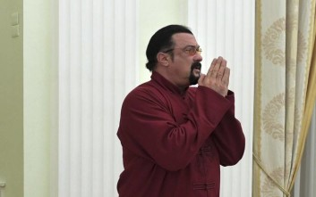Russian President Vladimir Putin, left, hosts U.S. actor Steven Seagal in the Kremlin in Moscow, Friday, Nov. 25, 2016. Putin has given a Russian passport to Seagal, a regular visitor to Russia in recent years, calling it a sign of a thaw in relations between the two countries.  (Alexei Druzhinin/Sputnik, Kremlin Pool Photo via AP)