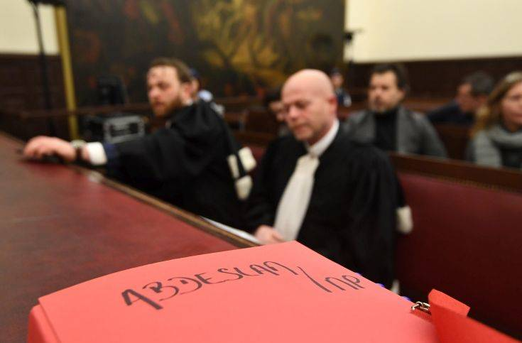 Belgian lawyer Sven Mary, center, attends the trial of Salah Abdeslam at the Brussels Justice Palace in Brussels on Monday, Feb. 5, 2018. Salah Abdeslam and Soufiane Ayari face trial for taking part in a shooting incident in Vorst, Belgium on March 15, 2016. The incident took place when six members of a Franco-Belgian research team investigating the attacks in Paris were conducting a search in an allegedly empty safe house of the terrorists and were attacked. (Emmanuel Dunand, Pool Photo via AP)