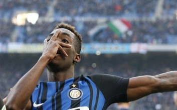 Inter Milan's Yann Karamoh celebrates after scoring his side's second goal during the Serie A soccer match between Inter Milan and Bologna at the San Siro stadium in Milan, Italy, Sunday, Feb. 11, 2018. (AP Photo/Antonio Calanni)
