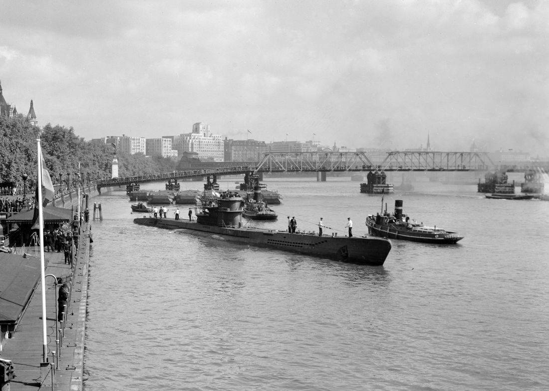 Surrendered German U-boat U776 moors at Westminster Pier, on the River Thames, London, May 22, 1945, where Londoners will be able to inspect her later in the week.  (AP Photo)