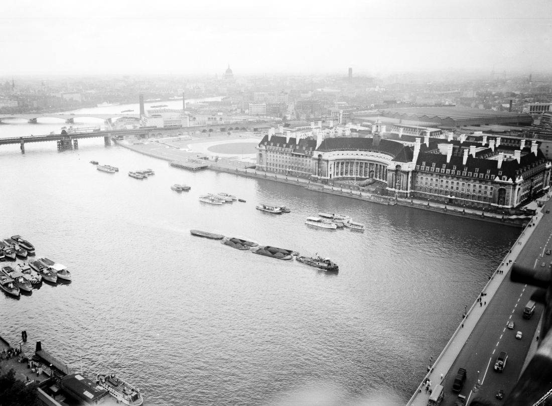 Picture taken from the top of 'Big Ben' clocktower of the Houses of Parliament, London, June 30, 1955. The bridge in right foreground is Westminster Bridge, the next bridge, centre left, is Hungerford Railway and Footpath Bridge and the next just above is Waterloo Bridge. The dome of St. Paul's Cathedral can be seen in the distance. The main building across the river is County Hall and just above that can be seen the huge roof of Waterloo Railway Station. (AP Photo/Staff/Worth)