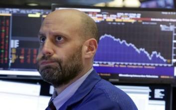 Στην κατηφόρα με σπασμένα φρένα η Wall Street