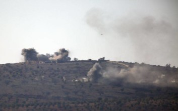 Smoke rises in the air from Turkish forces shelling inside Syria, as seen from the outskirts of the town of Kilis, Turkey, Tuesday, Jan. 30, 2018. Turkey launched a military offensive against the Kurdish enclave of Afrin on Jan. 20 to drive out the Syrian Kurdish People's Protection Units, or YPG, which is says are an extension of the outlawed Kurdish rebels inside Turkey. (AP Photo/Lefteris Pitarakis) (AP Photo/Lefteris Pitarakis)