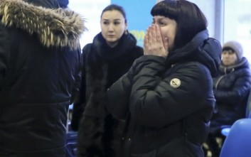 In this video grab provided by the ORSK.RU web site, Relatives and friends of those on the Saratov Airlines airline plane An-148 flight that crashed near Moscow's airport Domodedovo react while gathering at an airport outside Orsk, Russia, Sunday, Feb. 11, 2018. A Russian passenger plane carrying 71 people crashed Sunday near Moscow, killing everyone aboard shortly after the jet took off from one of the city's airports. The Saratov Airlines regional jet disappeared from radar screens a few minutes after departing from Domodedovo Airport en route to Orsk, a city some 1,500 kilometers (1,000 miles) southeast of Moscow. (Orsk.ru via AP)