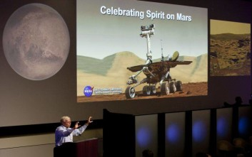 NASA Associate Administrator for the Science Mission Directorate Edward Weiler praises NASA's scientists and engineers gathered to pay tribute to the Mars rover Spirit Tuesday , July 19, 2011, at NASA's Jet Propulsion Laboratory in Pasadena, Calif. Spirit and its twin, Opportunity, landed on Mars in 2004 for what was supposed to be a three-month mission. Both survived longer than expected and uncovered geologic evidence that the red planet was once warmer and wet. Spirit operated on the surface for six years. In May, NASA declared Spirit dead after it had not responded to commands for more than a year. (AP Photo/Damian Dovarganes)