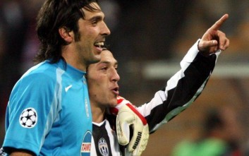 Turin's goalkeeper Gianluigi Buffon, left, and Mauro Camoranesi celebrate after their Group C UEFA Champions League soccer match between FC Bayern Munich and Italian soccer club Juventus Turin at the Olympic stadium in Munich, southern Germany, Wednesday, Nov. 3, 2004. Turin won by 1-0.  (AP Photo/Uwe Lein)