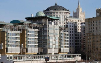 The British Embassy building, foreground, with the Russian Foreign Ministry building, background right, in Moscow, Russia, Friday, March 30, 2018. The Russian Foreign Ministry said Friday it has ordered Britain to reduce the number of its diplomats in Moscow to the level that Russia has in London, escalating a diplomatic war with the West over the poisoning of an ex-Russian spy in Britain. (AP Photo/Alexander Zemlianichenko)