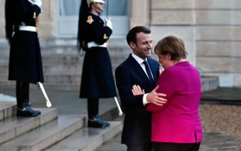 Το μέλλον της ευρωζώνης στο επίκεντρο της συνάντησης Μέρκελ - Μακρόν