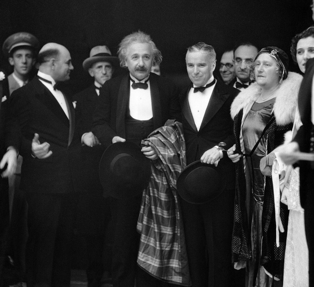 Dr. Albert Einstein, center, a German physicist, stands with his wife Elsa Einstein, and Charles Chaplin, second right, as they arrive for the opening of Chaplin's silent movie, in Los Angeles, Calif., Feb. 2, 1931. (AP Photo)