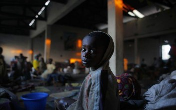 A internally displaced Congolese child sits in the church where he and others found refuge on the outskirts of Goma, eastern Congo, Friday, Aug. 3, 2012. The first case of cholera has emerged among thousands of people in an impromptu refugee camp in eastern Congo who fled fighting between a new rebel group and government forces backed by U.N. peacekeepers, Doctors Without Borders reported. Congo's army now controls only the city of Goma and the village of Kibumba, 10 kilometers (six miles) outside Goma. Now the rebels hold all towns going north as far as Rutshuru and are threatening to besiege Goma. The U.N. Security Council on Thursday demanded that the M23 rebel group halt any advances toward Goma. (AP Photo/Jerome Delay)