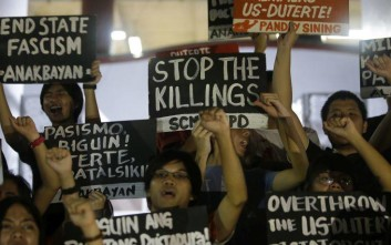 "Student protesters shout slogans during a rally in metropolitan Manila, Philippines on Friday, Jan. 26, 2018. Manila's top diplomat has accused Human Rights Watch of deceiving the international community by making it appear ""that the Philippines has become the Wild, Wild West of Asia where we just kill people left and right."" Foreign Secretary Alan Peter Cayetano demanded an apology Friday from the U.S.-based rights group for reporting a larger number of drug suspects killed in President Rodrigo Duterte's crackdown on illegal drugs to back up a statement that human rights in the Philippines ""is at its worst."" (AP Photo/Aaron Favila)"