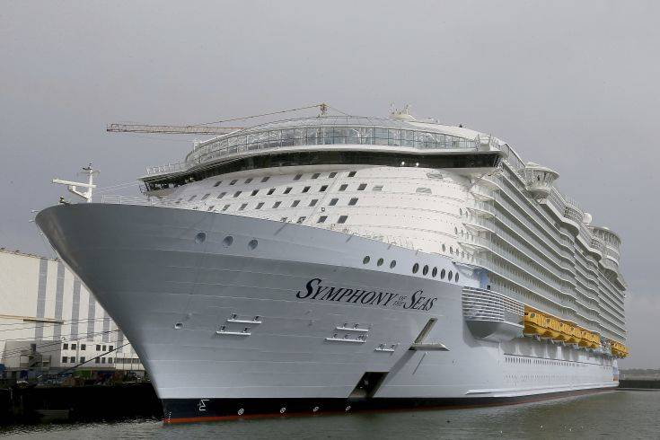 The Symphony of the Seas docks at Saint Nazaire port, western France, Friday, March 23, 2018. Royal Caribbean International took delivery of the much-awaited, 228,081-ton Symphony of the Seas from the French shipyard STX. Harmony of the Seas is the world's largest cruise ship. (AP Photo/David Vincent)