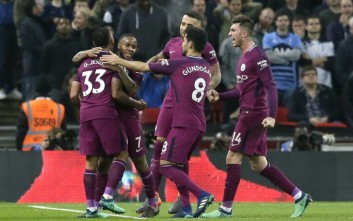 Manchester City's Raheem Sterling,2nd left,, celebrates after scoring his side's third goal during the English Premier League soccer match between Tottenham Hotspur and Manchester City at Wembley stadium in London, England, Saturday, April 14, 2018. (AP Photo/Tim Ireland)