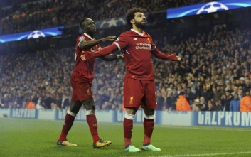 Liverpool's Mohamed Salah, right, celebrates scoring his side's first goal with Liverpool's Sadio Mane during the Champions League quarterfinal second leg soccer match between Manchester City and Liverpool at Etihad stadium in Manchester, England, Tuesday, April 10, 2018. (AP Photo/Rui Vieira)
