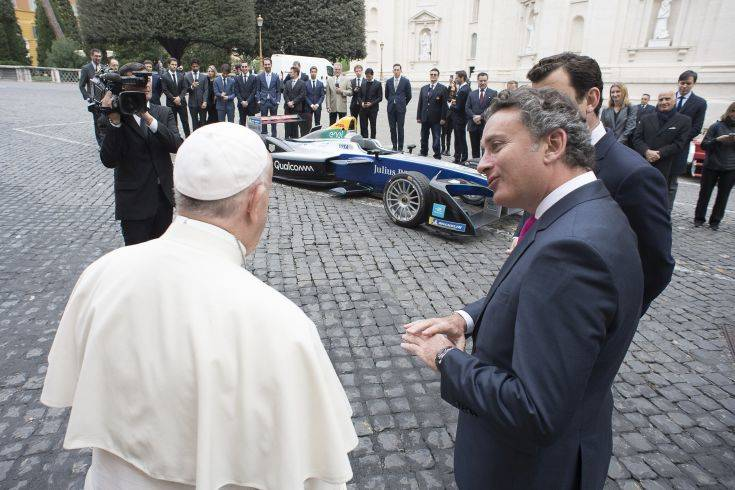 Pope Francis is flanked by Formula E CEO Alejandro Agag before blessing the Formula E electric official car, at the Vatican, Wednesday, April 11, 2018. A Formula E race will be held in Rome EUR district, Saturday, April 14. (Vatican Media via AP)