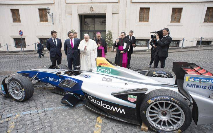 Pope Francis blesses the Formula E electric official car, at the Vatican, Wednesday, April 11, 2018. A Formula E race will be held in Rome EUR district, Saturday, April 14. (Vatican Media via AP)