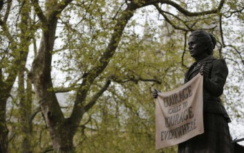 The newly unveiled statue of Millicent Fawcett in Parliament Square, London, Tuesday, April 24, 2018.  Britain's Prime Minister Theresa May has helped unveil a statue of women's rights campaigner Millicent Fawcett outside Britain's Parliament. Fawcett is the first woman to be commemorated there alongside 11 statues of men including Nelson Mandela and Winston Churchill. (AP Photo/Alastair Grant)