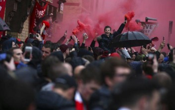Liverpool supporters light red flares outside the stadium before the Champions League semifinal, first leg, soccer match between Liverpool and AS Roma at Anfield Stadium, Liverpool, England, Tuesday, April 24, 2018. (AP Photo/Dave Thompson)