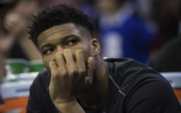 Milwaukee Bucks' Giannis Antetokounmpo, of Greece, looks on while on the bench during the second half of an NBA basketball game against the Philadelphia 76ers, Wednesday, April 11, 2018, in Philadelphia. The 76ers won 130-95. (AP Photo/Chris Szagola)