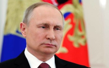 Russian President Vladimir Putin speaks during a live televised speech in Moscow, Russia, Friday, March 23, 2018. Russian electoral officials have officially declared incumbent President Vladimir Putin the winner of last Sunday's election. The Central Election Commission on Friday issued final results, showing that Putin won nearly 77 percent of the vote. Communist candidate Pavel Grudinin came second with nearly 12 percent. (Mikhail Klimentyev, Sputnik, Kremlin Pool Photo via AP)