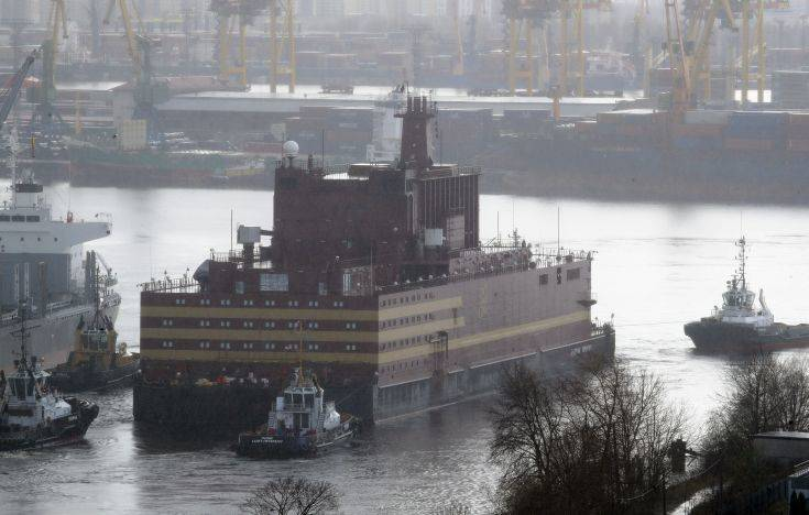 The floating nuclear power plant, the 'Akademik Lomonosov', is towed out of the St. Petersburg shipyard where it was constructed in St.Petersburg, Russia, Saturday, April 28, 2018. The Akademik Lomonosov is to be loaded with nuclear fuel in Murmansk, then towed to position in the Far East in 2019.(AP Photo/Dmitri Lovetsky)