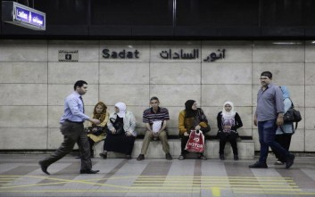 Passengers wait for a train at the Sadat metro station located beneath Tahrir Square, in Cairo, Egypt, Wednesday, June 17, 2015. Sadat station, one of Cairo's largest, re-opened after nearly two years of closure for security reasons. The sprawling underground station is one of only two stations where passengers can switch subway lines and its long-term closure has added significant time to many riders' daily journeys. (AP Photo/Thomas Hartwell)
