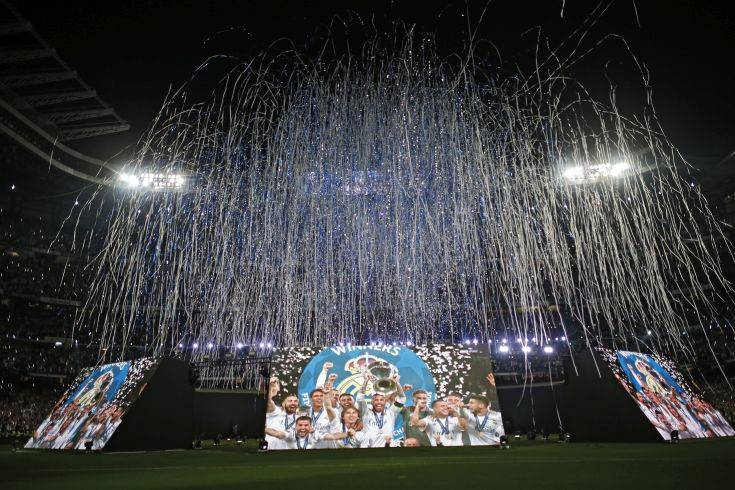 Real Madrid supporters watch on big screens placed at the team's Santiago Bernabeu stadium in Madrid, Spain, for the celebration of their team winning the Champions League final match against Liverpool played in Kiev, Ukraine,  Saturday, May 26, 2018. Real Madrid won 3-1. (AP Photo/Francisco Seco)