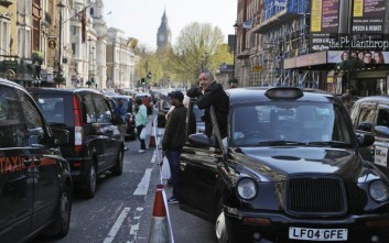 London black cab drivers block a road in Whitehall to protest against government public transport plans, in London Thursday, April 6, 2017. (AP Photo/Frank Augstein)