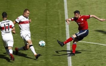 Stuttgart's Holger Badstuber blocks a shot by Bayern's Robert Lewandowski, right, during the German Soccer Bundesliga match between FC Bayern Munich and VfB Stuttgart in Munich, Germany, Saturday, May 12, 2018. (AP Photo/Matthias Schrader)