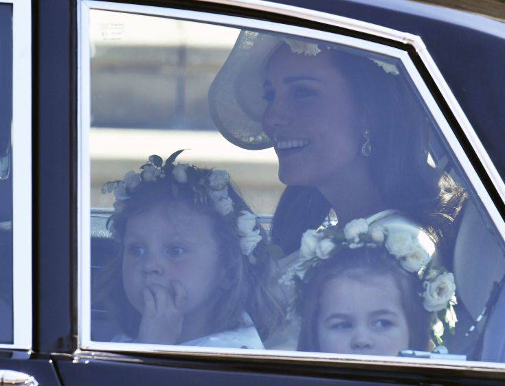 Kate, Duchess of Cambridge arrives with the Princess Charlotte, right, for the wedding ceremony of Prince Harry and Meghan Markle at St. George's Chapel in Windsor Castle in Windsor, near London, England, Saturday, May 19, 2018. (Ben Birchhall/pool photo via AP)