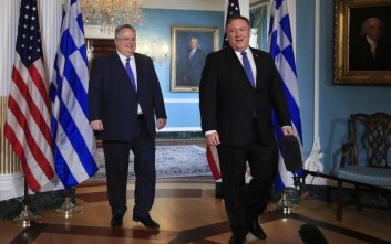 Secretary of State Mike Pompeo, right, and Greek Foreign Minister Nikos Kotzias walk to the Treaty Room at the State Department in Washington, Monday, May 21, 2018. (AP Photo/Manuel Balce Ceneta)