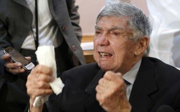 FILE - In this April 13, 2011, file photo, anti-Castro activist Luis Posada Carriles gestures as he responds to a reporter during a news conference in Miami. A lawyer for him said the militant Cuban exile has died Wednesday, May 23, 2018, at a South Florida care home for elderly veterans. He was 90. (AP Photo/Alan Diaz, File)