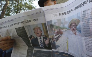 "An activist reads a news paper reporting canceled summit between U.S. President Donald Trump, left, and North Korean leader Kim Jong Un during the 2018 DMZ Women Peace Walk at the Imjingak Pavilion in Paju, South Korea, Saturday, May 26, 2018. South Korea on Saturday expressed cautious relief about the revived talks for a summit between President Donald Trump and North Korean leader Kim Jong Un following a whirlwind 24 hours that saw Trump canceling the highly-anticipated meeting before saying it's potentially back on. The headline read: "" Embarrassed Kim Jong Un"". (AP Photo/Ahn Young-joon)"