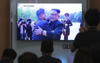 People watch a TV screen showing South Korean President Moon Jae-in, left, meets with North Korean leader Kim Jong Un at the border village of Panmunjom during a news program at the Seoul Railway Station in Seoul, South Korea, Saturday, May 26, 2018. Kim and Moon met for the second time in a month on Saturday to discuss carrying out the peace commitments they reached in their first summit and Kim's potential meeting with President Donald Trump, Moon's office said. (AP Photo/Ahn Young-joon)