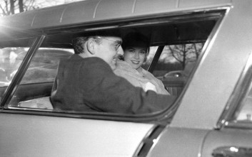 Prince Rainier III of Monaco, one of the world's most eligible bachelors, and motion picture queen Grace Kelly smile as they drive from the Philadelphia Country Club after their engagement was formally announced by Miss Kelly's parents on Jan. 5, 1956. (AP Photo/Bill Ingraham)