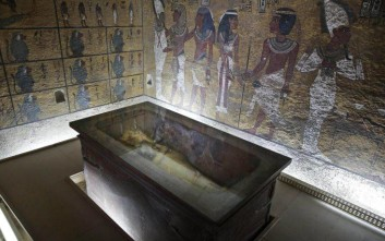 FILE -- In this Tuesday, Sept. 29, 2015 file photo, the tomb of King Tut is displayed in a glass case at the Valley of the Kings in Luxor, Egypt, Tuesday. On Saturday, Nov. 28, 2015, Antiquities Minister Mamdouh el-Damaty said there is a 90 percent chance that hidden chambers will be found within King Tutankhamun's tomb, based on the preliminary results of a new exploration of the 3,300-year-old mausoleum. (AP Photo/Nariman El-Mofty, File)