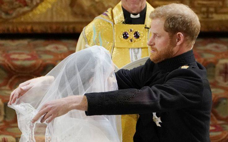 Britain's Prince Harry removes the veil of Meghan Markle during their wedding ceremony at St. George's Chapel in Windsor Castle in Windsor, near London, England, Saturday, May 19, 2018. (Owen Humphreys/pool photo via AP)