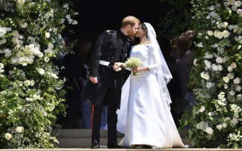 Britain's Prince Harry and his wife Meghan Markle kiss after their wedding ceremony at St. George's Chapel in Windsor Castle in Windsor, near London, England, Saturday, May 19, 2018. (Ben Stansall/pool photo via AP)