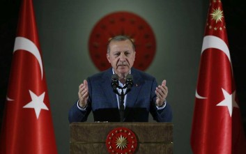 Turkey's President Recep Tayyip Erdogan speaks during an Iftar, the evening meal breaking the Ramadan fast, at his palace in Ankara, Turkey, Saturday, May 19, 2018. Erdogan called snap presidential and parliamentary elections a year and a half before schedule. The elections will usher in a new executive presidential system that increases the powers of the president. (Presidential Press Service/Pool via AP)