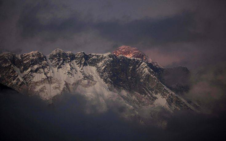 FILE - In this Oct. 27, 2011 file photo, the last light of the day sets on Mount Everest as it rises behind Mount Nuptse as seen from Tengboche, in the Himalaya's Khumbu region, Nepal. Famed Swiss climber Ueli Steck was killed Sunday, April 30, 2017, in a mountaineering accident near Mount Everest in Nepal, expedition organizers said. Mingma Sherpa of the Seven Summit Treks said Steck was killed at Camp 1 of Mount Nuptse. (AP Photo/Kevin Frayer, File)