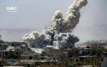 This photo provided Monday, Sept 25, 2017, by the Ghouta Media Center, a Syrian activist media group, shows smoke and debris rising after Syrian government shelling of the rebel-held Jobar neighborhood of Damascus, Syria. Activists and monitoring groups reported airstrikes in Aleppo, Idlib and Hama provinces, as well as clashes between rebels and pro-government forces in northern Syria and on the outskirts of the capital, Damascus. (Ghouta Media Center, via AP)
