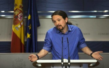 Spain's Podemos Party leader Pablo Iglesias talks to journalists during a news conference after his meeting with Spain's King Felipe, at the Spanish parliament in Madrid, Tuesday, April 26, 2016. King Felipe is wrapping up two days of talks with political party leaders in a last-ditch bid to snap a four-month deadlock in finding a candidate capable of forming a government, but another election looks more likely. (AP Photo/Francisco Seco)