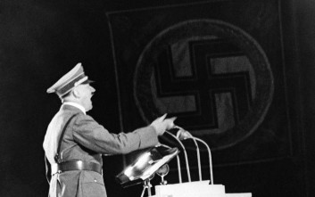 Nearly a million people packed the May field to hear German Chancellor Adolf Hitler and Italian dictator Benito Mussolini speak. Both dictators made pledges of peace. A striking study of Adolf Hitler during his speech in Berlin, on Sept. 28, 1937. (AP Photo)