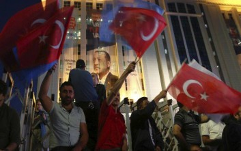 Supporters of Turkey's President and leader of ruling Justice and Development Party Recep Tayyip Erdogan celebrate outside his party's headquarters in Ankara, Turkey, late Sunday, June 24, 2018. Erdogan has claimed victory in critical elections based on unofficial results, securing an executive presidency with sweeping powers. (AP Photo/Ali Unal)