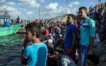 FILE -- In this Sept. 22, 2016 file photo, Egyptians wait on shore as a coast guard boat arrives carrying the bodies recovered from a Europe-bound boat that capsized off Egypt's Mediterranean coast, in Rosetta, Egypt. Rescue workers on Tuesday, Sept. 27, 2016, pulled dozens of bodies from the hold of an Egyptian fishing boat that sank in the Mediterranean Sea last week, carrying hundreds of migrants, bringing the toll from the disaster to more than 200 dead. Families of those missing gathered at a pier outside the coastal city of Rosetta as the dead were brought to shore, and relatives went through the grisly task of searching through the body bags for their loved ones. (AP Photo/Eman Helal, File)